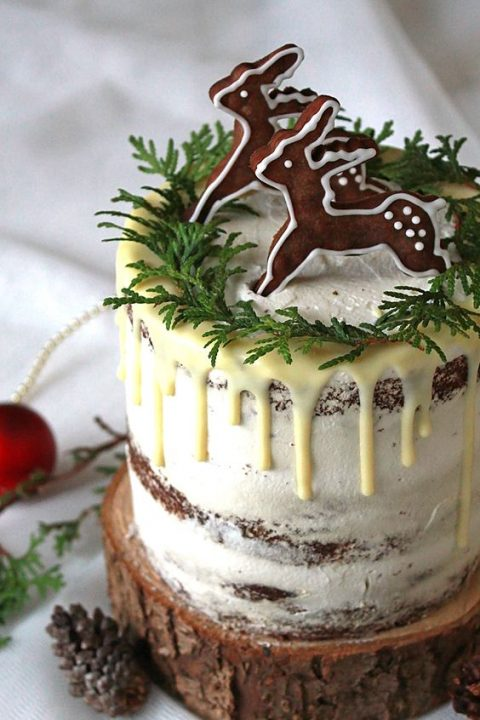 semi naked chocolate wedding cake with drip_ greenery and gingerbread cookies