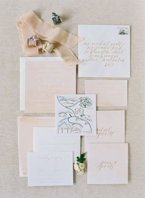 a blush wedding stationery suite and a watercolor map