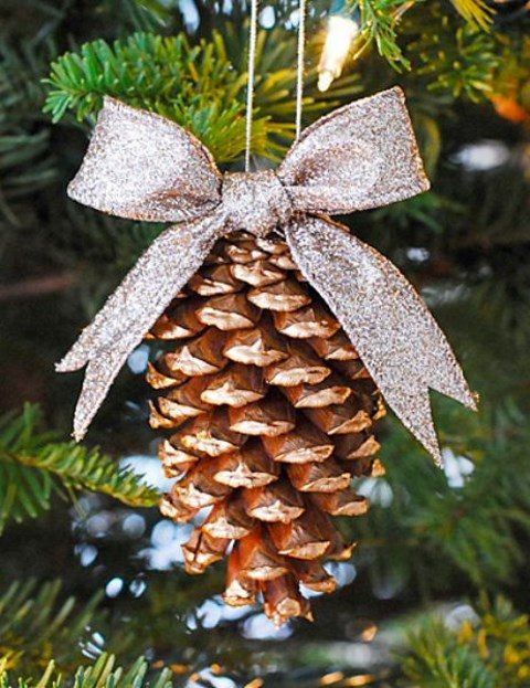 a gilded pinecone ornament with a glitter bow can be a favor