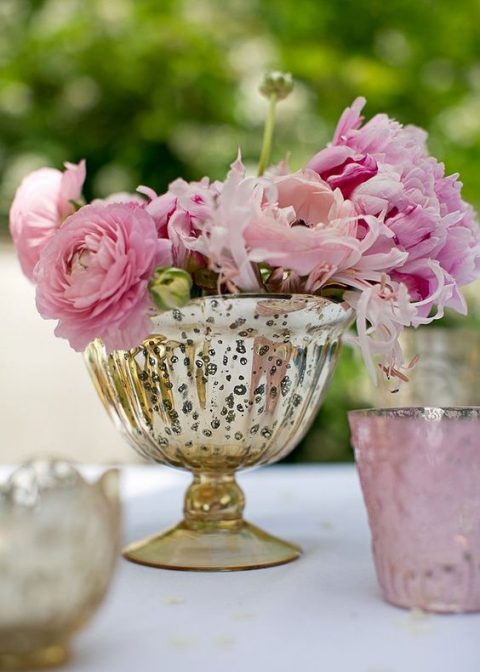 a gold mercury glass compote bowl with pink blooms