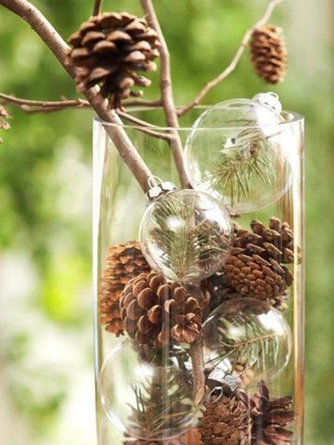 a natural winter centerpiece with pinecones and transparent ornaments with fir branches