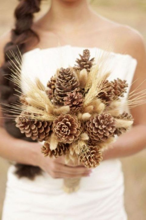 a pinecone and wheat wedding bouquet
