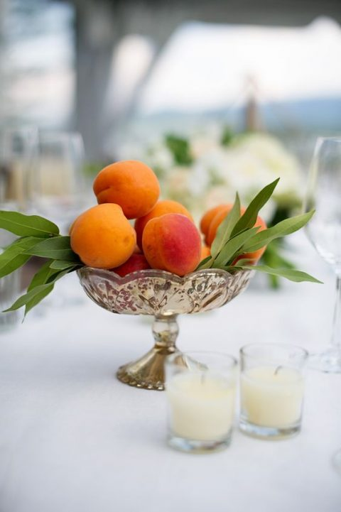 a vintage bowl with fresh apricots and greenery
