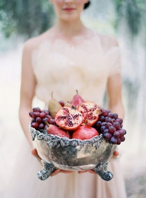 a vintage silver bowl with fresh fruits