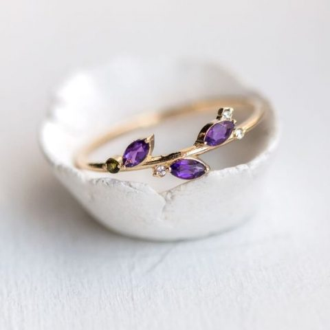 a wedding band with ultra violet rhinestones and diamonds