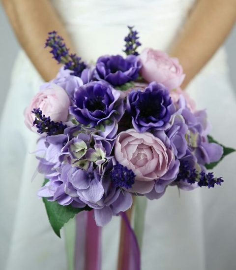 a wedding bouquet in the shades of pink and violet