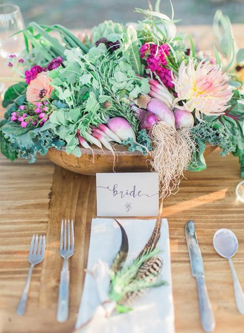 a wooden bowl with fresh veggies and blooms for a farm wedding