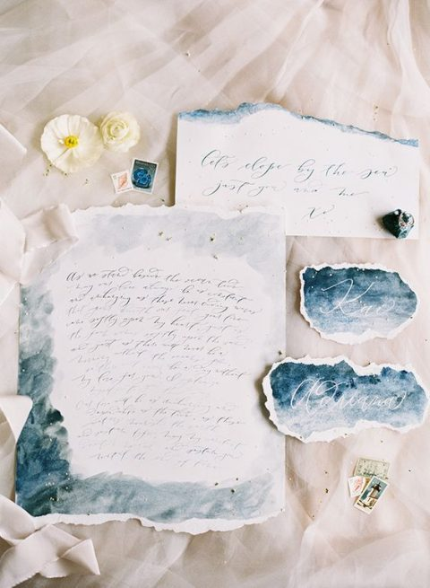 airy blue and grey watercolor wedding stationery with a raw edge