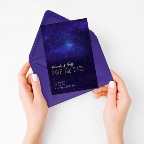 an ultra violet envelope with a starry night sky save the date