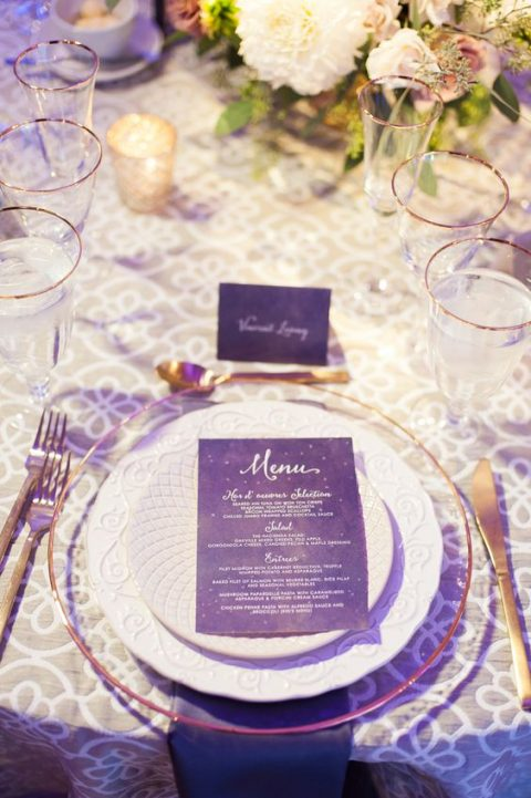 an ultra violet menu and place card with a matching napkin