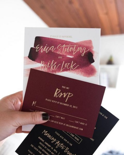 black, burgundy and gold calligraphy wedding stationery and a watercolor burgundy card