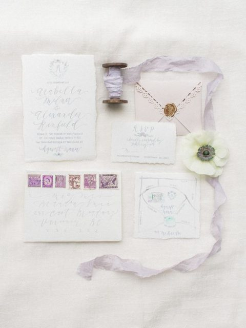 blush and neutral wedding stationery with lilac ribbon