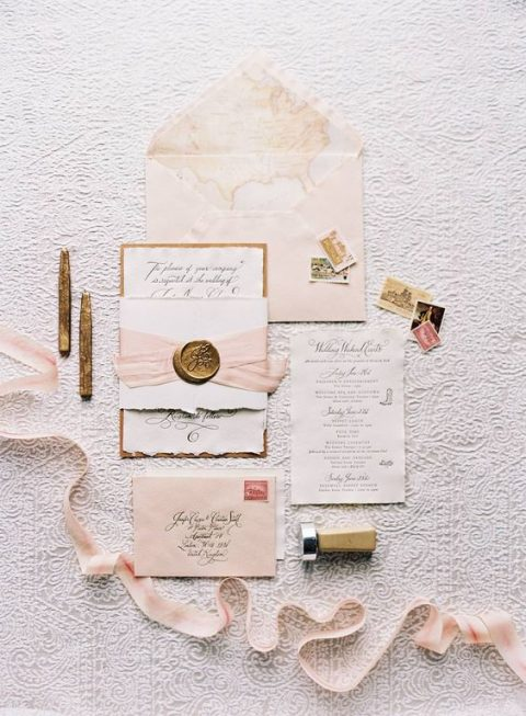 blush wedding invitation suite with map lining, seals and blush ribbons