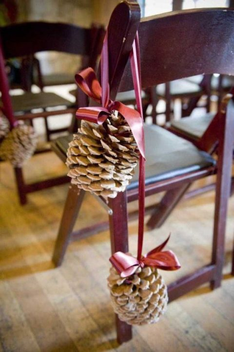 large snowy pinecones with pink ribbon bows