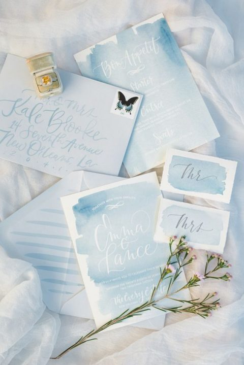 light blue watercolor wedding stationery with calligraphy