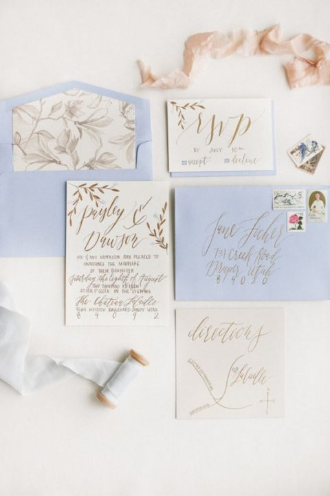 lilac wedding stationery with floral lining and calligraphy in gold
