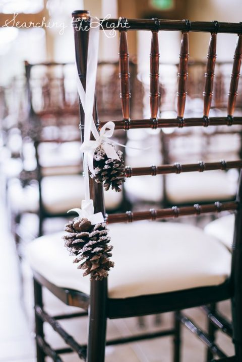 little snowy pinecones on white ribbon are great for decorating the aisle