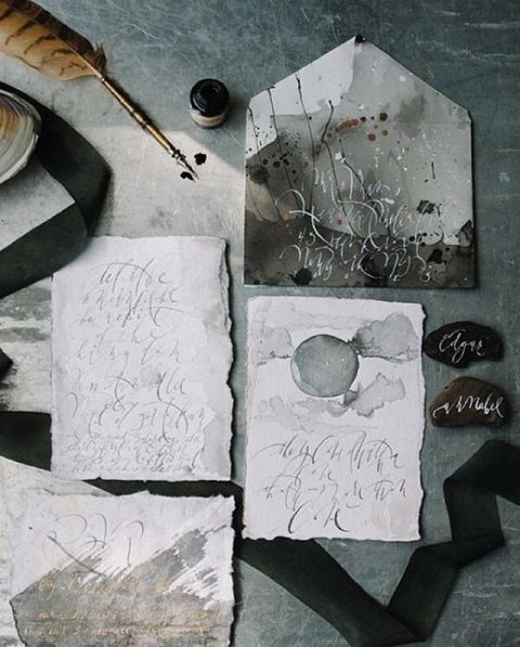 moody watercolor grey wedding stationery with a raw edge
