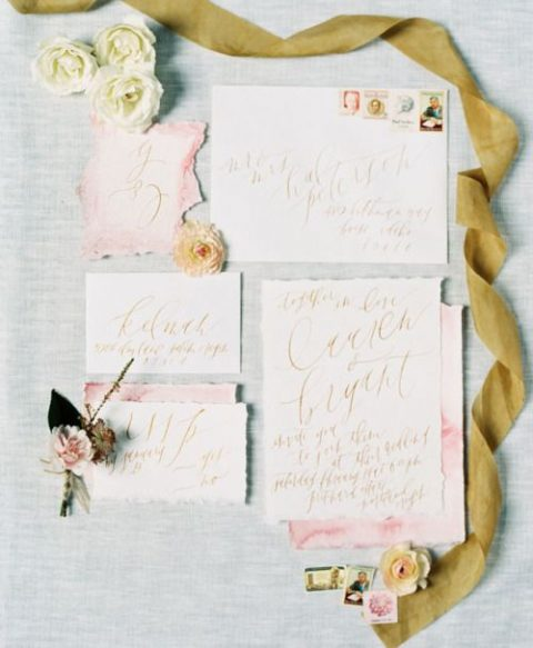 pastel pink wedding invitation set with a raw edge, gold calligraphy