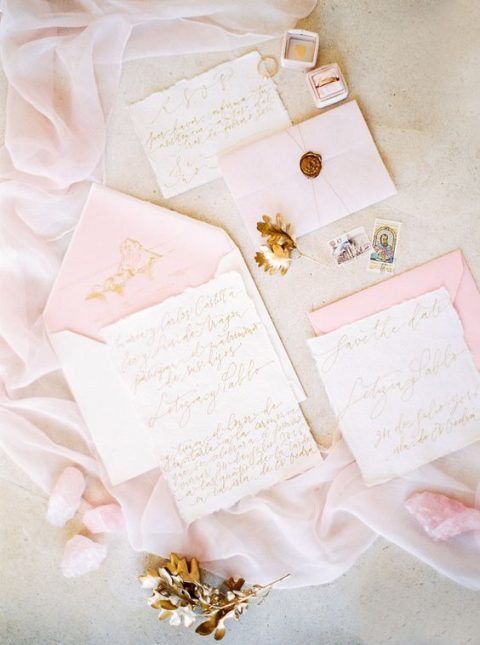 pink wedding invitations with gold calligraphy, seals and threads
