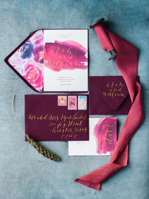 plum-colored envelopes, pink and purple watercolor wedding invites