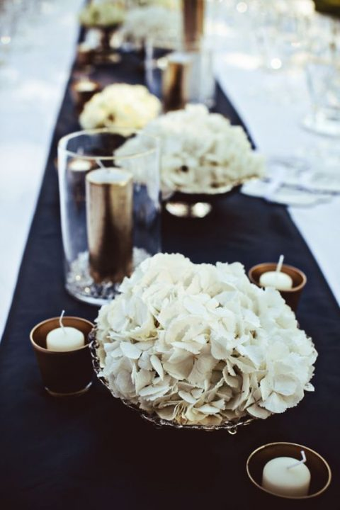 silver bowls with white blooms and candles around
