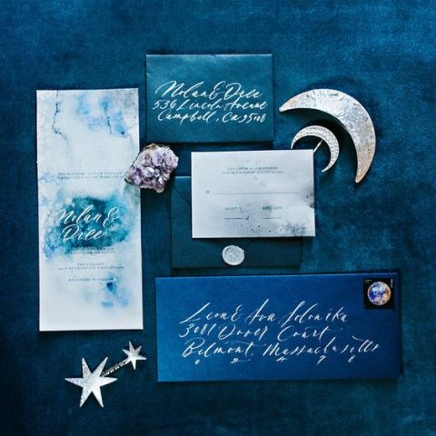 starry night themed wedding stationery with watercolor teal and grey invites