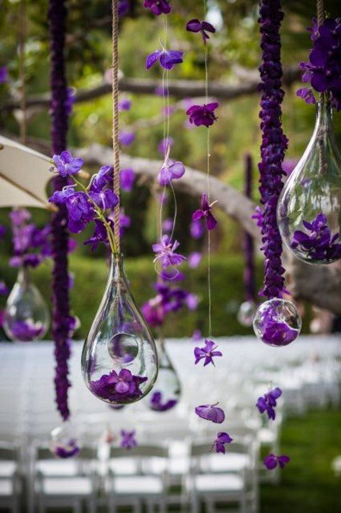 ultra violet blooms hanging over the ceremony space