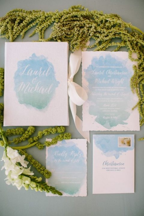 watercolor pastel blue wedding stationery with a raw edge and creamy ribbons