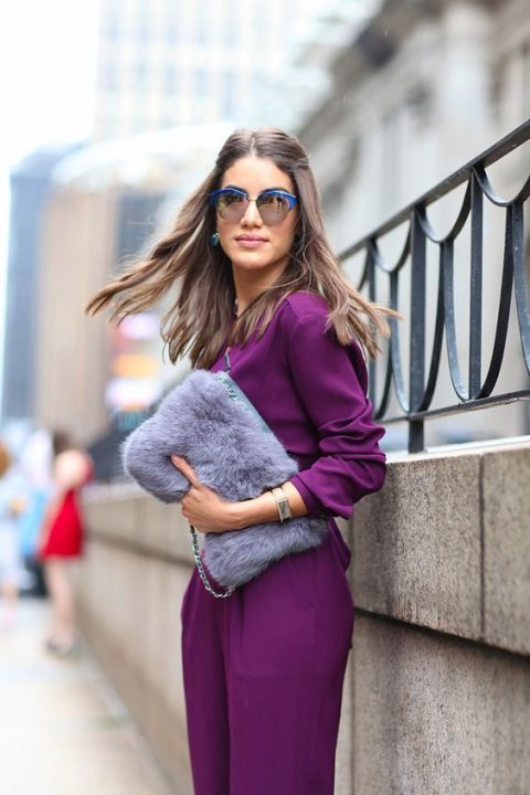 wear and ultra violet jumpsuit and a lavender faux fur clutch