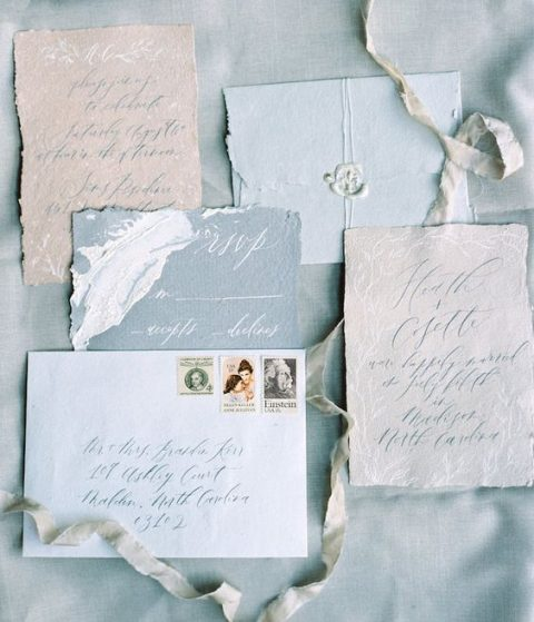 wedding invitation suite in the shades of grey and blue with a raw edge