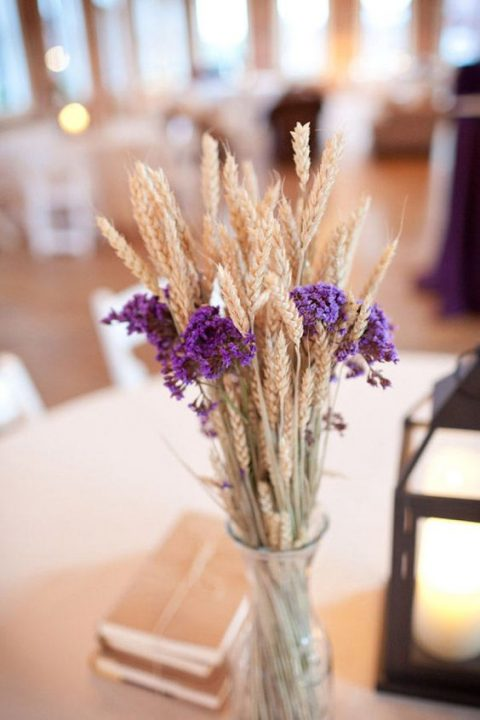 wheat and violet flowers centerpiece for a cozy rustic wedding