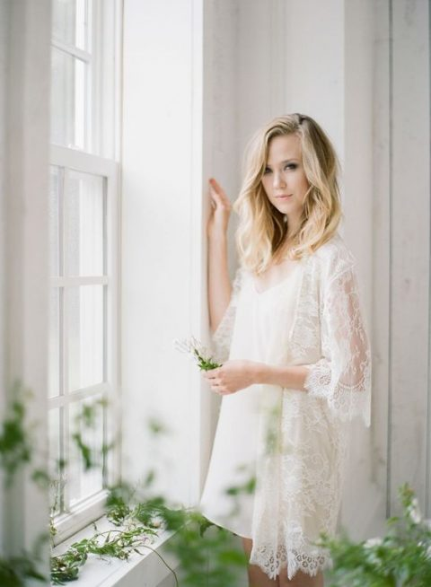 a lace bridal robe with bell sleeves and a sleek bridal chemise