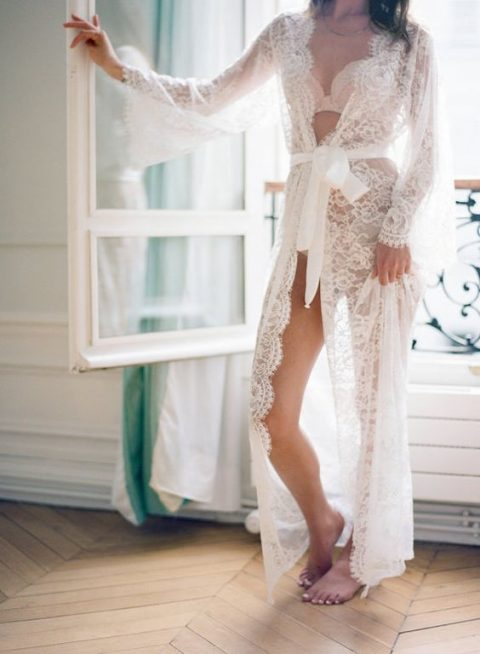 a long lace bridal robe with long sleeves and a silk sash