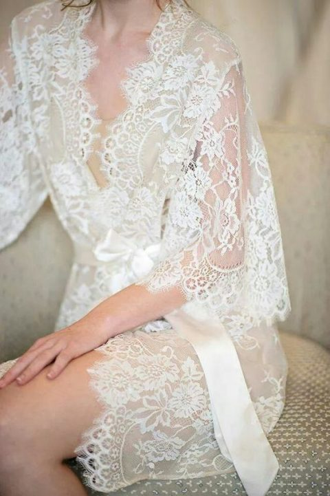 a refined lace bridal robe with bell sleeves and a silk sash