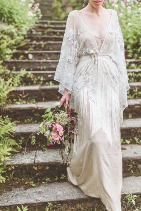 a romantic vintage-inspired wedding gown with embellishments, fringe and a deep V-neckline