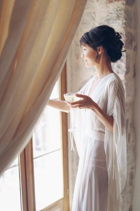 a sheer bridal robe with bell sleeves