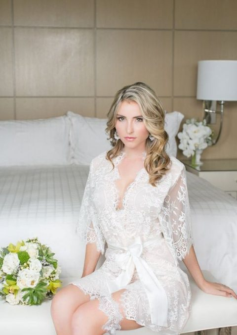 a short lace bridal robe with short sleeves and a matching garter