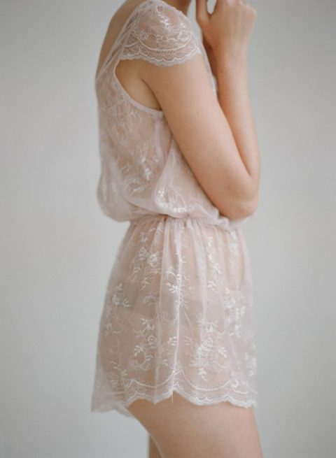 a short lace bridal romper with cap sleeves