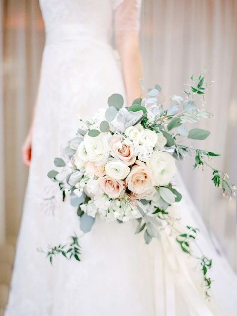 a tender neutral wedding bouquet in cream and blush plus pale eucalyptus