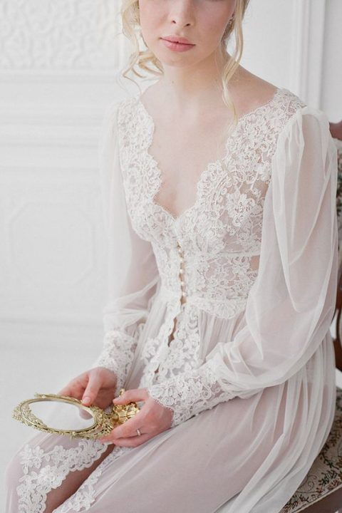 a vintage-inspired lace bridal robe with pearl buttons and puff sleeves
