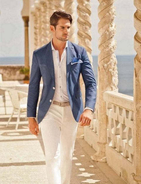 a white shirt and pants, a bold blue jacket, no tie