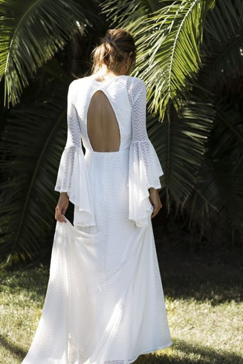 bell sleeve wedding dress with a high neckline and a cutout back by Grace Loves Grace