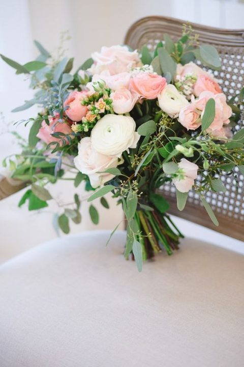 coral pink and cream wedding blooms with foliage