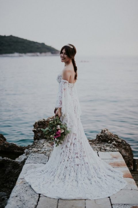 off the shoulder bell sleeve wedidng dress for a beach boho bride