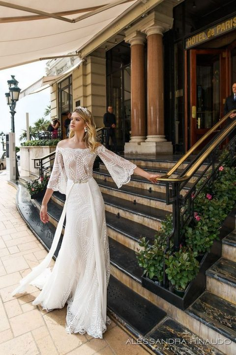 abc57625f6d off the shoulder wedding dress with bell sleeves and a layered skirt by  Alessandra Rinaudo