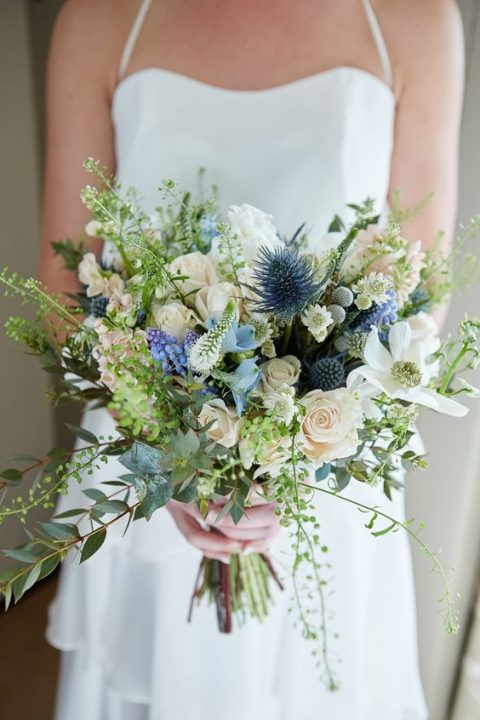 wild-looking spring wedidng bouquet with blue thistle, herbs and neutral blooms