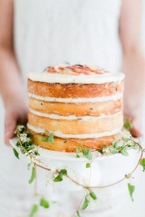 a naked cake with some greenery is simple spring beauty
