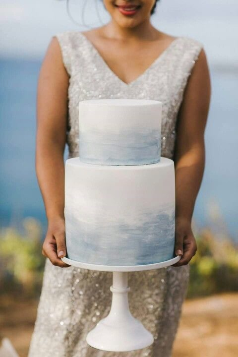 a wedding cake with dusty blue watercolor