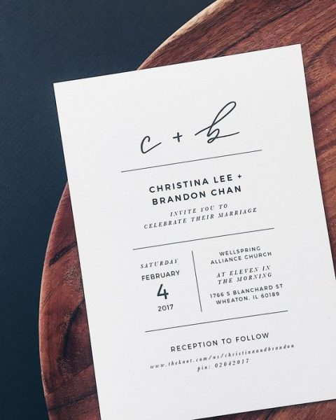 minimalist black and white hand lettered wedding invitation